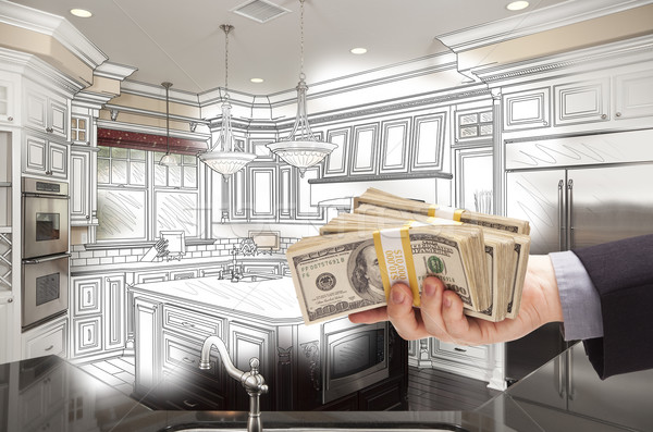 Hand Holding Cash Over Kitchen Design Drawing and Photo Combinat Stock photo © feverpitch