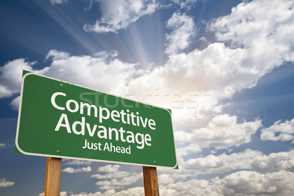 Competitive Advantage Green Road Sign Over Clouds Stock photo © feverpitch