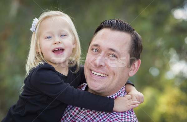 Adorable Little Girl Having Fun With Daddy Outdoors Stock photo © feverpitch