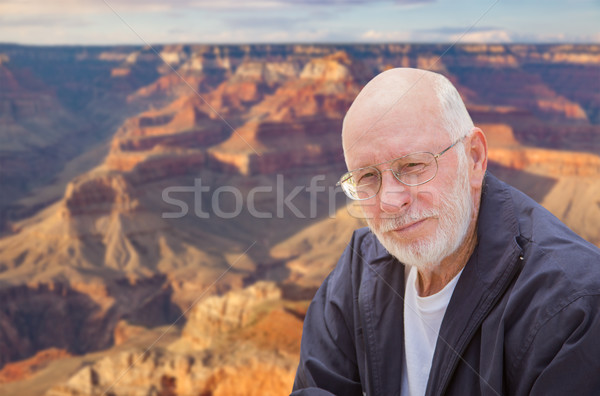 Happy Senior Man Posing on Edge of The Grand Canyon Stock photo © feverpitch