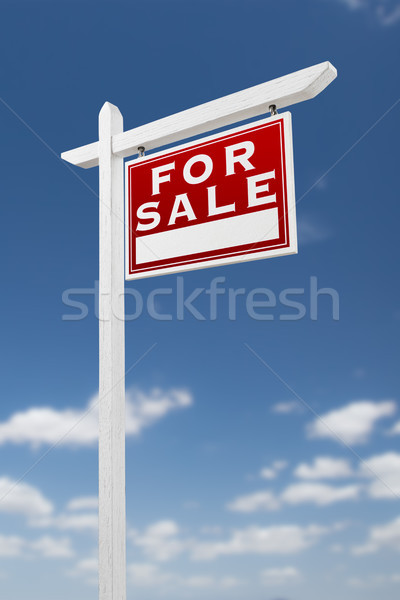 Right Facing For Sale Real Estate Sign on a Blue Sky with Clouds Stock photo © feverpitch