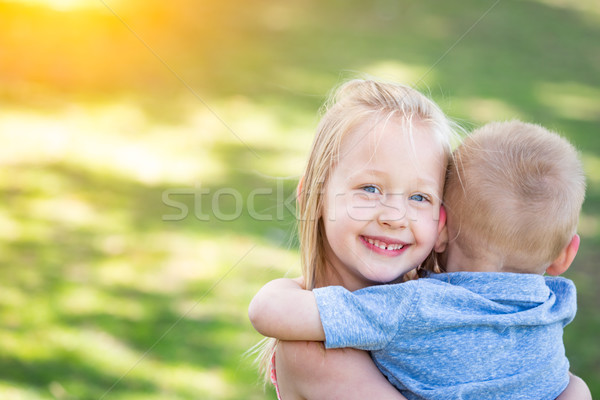 Young Brother and Sister Hugging At The Park Stock photo © feverpitch