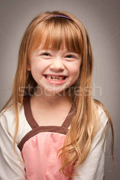 Fun Portrait of an Adorable Red Haired Girl on Grey Stock photo © feverpitch