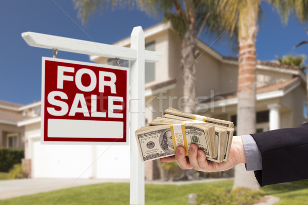 Buyer Handing Over Cash for House with For Sale Sign Stock photo © feverpitch