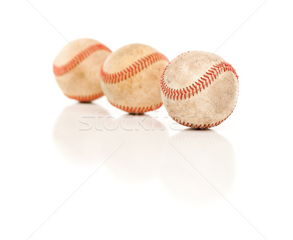 Three Baseballs Isolated on Reflective White Stock photo © feverpitch