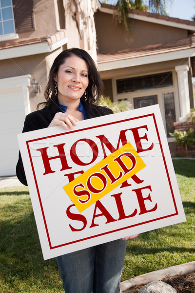 Woman Holding Sold Real Estate Sign In Front of House Stock photo © feverpitch