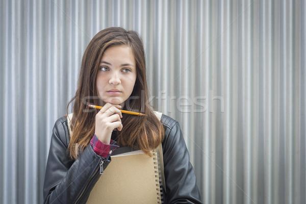 Genç melankoli kadın öğrenci kitaplar bakıyor Stok fotoğraf © feverpitch