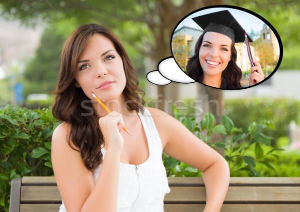 Nadenkend jonge vrouw afgestudeerde binnenkant dacht gedachte bel Stockfoto © feverpitch