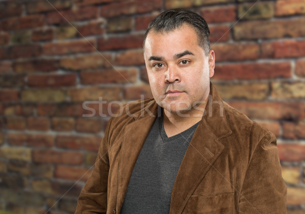 Handsome Young Hispanic Male Headshot Portrait Against Brick Wal Stock photo © feverpitch
