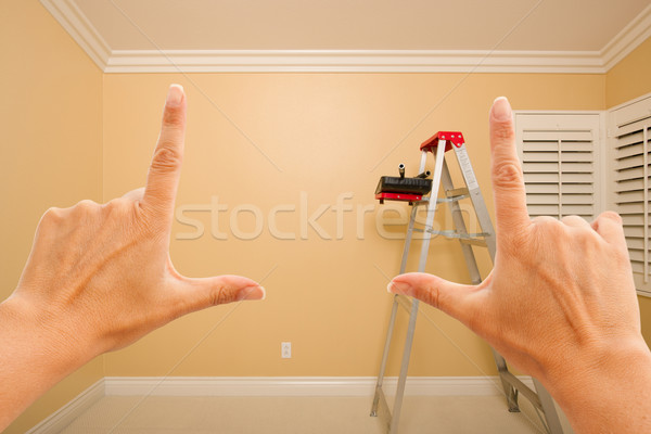 Female Hands Framing Beautiful Room Interior Stock photo © feverpitch