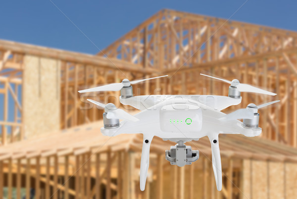 Stock photo: Unmanned Aircraft System (UAV) Quadcopter Drone In The Air Over