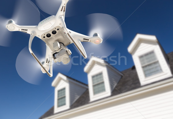Drone Quadcopter Flying, Inspecting and Photographing House Stock photo © feverpitch