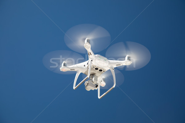 Drone Quadcopter From Below Against A Blue Sky Stock photo © feverpitch