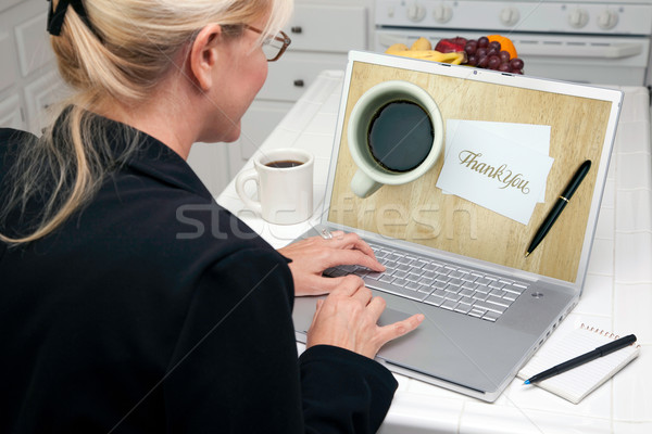 Woman In Kitchen Using Laptop - E-commerce Stock photo © feverpitch
