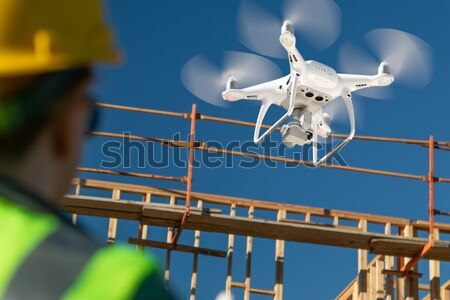 Unmanned Aircraft System (UAS) Quadcopter Drone In The Air Near  Stock photo © feverpitch