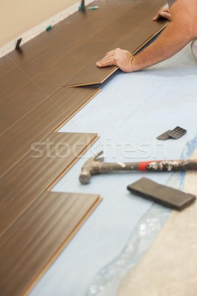 Man Installing New Laminate Wood Flooring Stock photo © feverpitch