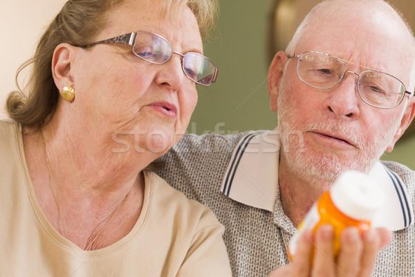 Senior Couple Reading Medicine Bottle Stock photo © feverpitch