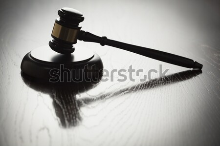 Dramatic Gavel Silhouette on Reflective Wood Stock photo © feverpitch