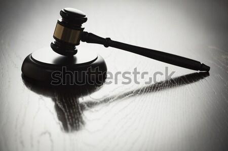 Dramatique marteau silhouette réfléchissant bois surface Photo stock © feverpitch