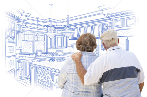 Senior Couple Looking Over Blue Custom Kitchen Design Drawing Stock photo © feverpitch