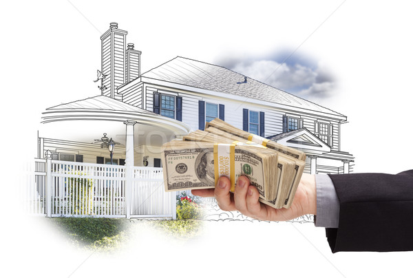 Hand Holding Thousands In Cash Over House Drawing and Photo Stock photo © feverpitch