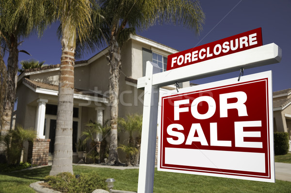 Stock photo: Foreclosure For Sale Real Estate Sign and House