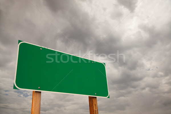 Blank Green Road Sign Over Storm Clouds Stock photo © feverpitch