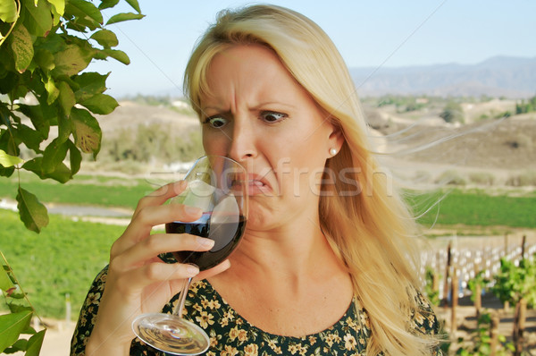 Shocked Attractive Woman Sips Wine Stock photo © feverpitch