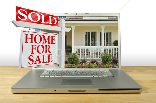 Sold Home For Sale Sign on Laptop Stock photo © feverpitch