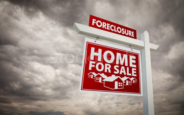 Red Foreclosure Home For Sale Real Estate Sign Over Cloudy Sky Stock photo © feverpitch