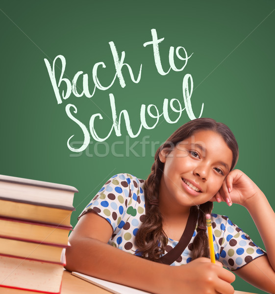 Cute Hispanic Girl Studying In Front of Back To School Written o Stock photo © feverpitch