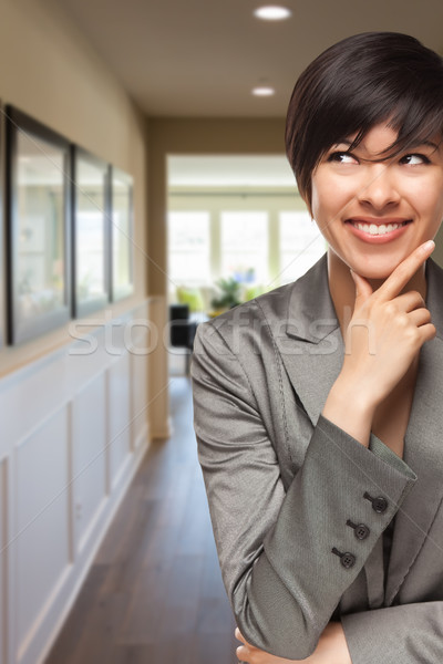 Curious Mixed Race Woman Inside Hallway of House Stock photo © feverpitch