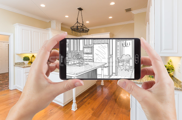 Stock photo: Hands Holding Smart Phone Displaying Drawing of Kitchen Photo Be