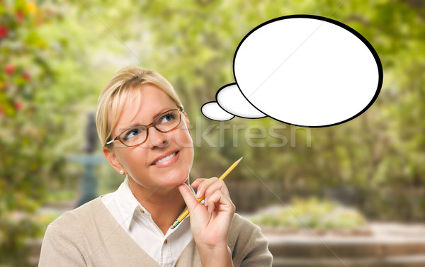 Thoughtful Young Woman with Pencil and Blank Thought Bubble. Stock photo © feverpitch