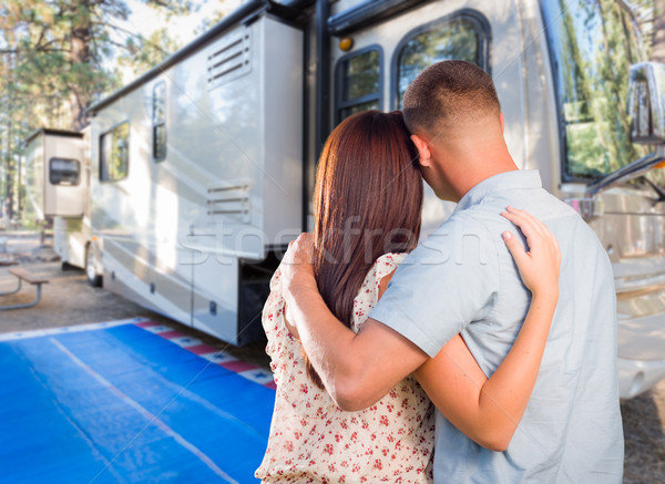 Military Couple Looking At A Beautiful RV At The Campground. Stock photo © feverpitch