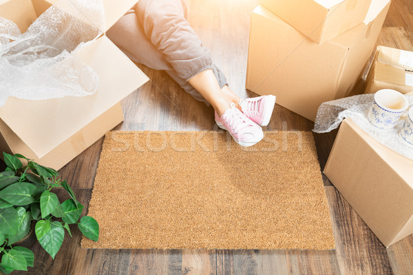 Woman Wearing Sweats Relaxing Near Home Sweet Home Welcome Mat,  Stock photo © feverpitch