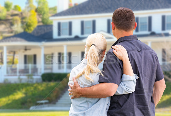 Young Adult Couple Facing Front of Beautiful House Stock photo © feverpitch