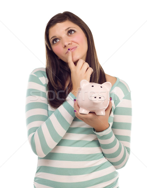Ethnic Female Daydreaming and Holding Piggy Bank on White Stock photo © feverpitch