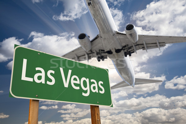 Stock photo: Las Vegas Green Road Sign and Airplane Above
