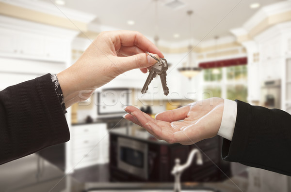 Handing Over New House Keys Inside Beautiful Home Stock photo © feverpitch