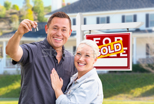 Young Adult Couple With House Keys In Front of Home and Sold For Stock photo © feverpitch