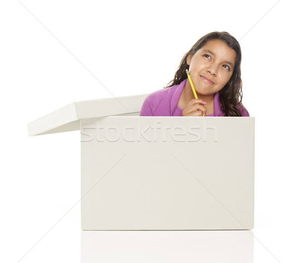 Ethnic Female Popping Out and Thinking Outside The Box Stock photo © feverpitch