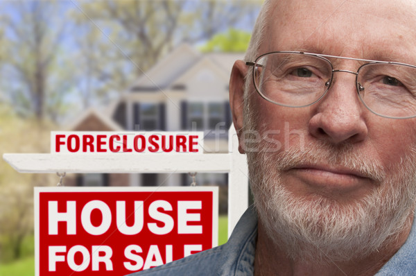 Depressed Senior Man in Front of Foreclosure Sign and House Stock photo © feverpitch