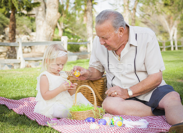 Grandfather and Granddaughter Enjoying Easter Eggs on Blanket At Stock photo © feverpitch
