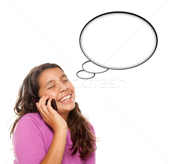 Hispanic Teen Aged Girl on Cell Phone with Blank Thought Bubble Stock photo © feverpitch
