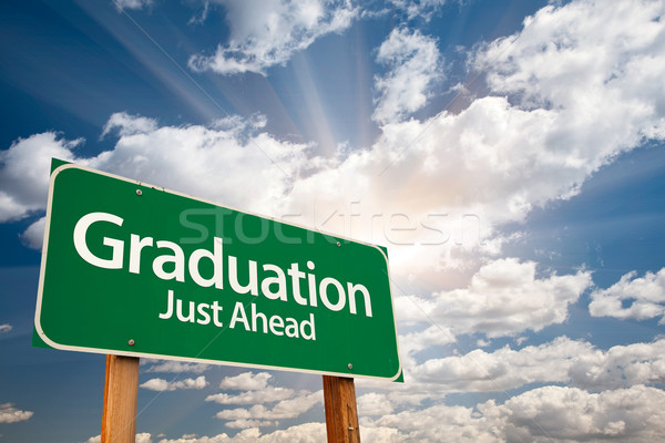 Graduation Green Road Sign Over Clouds Stock photo © feverpitch
