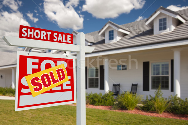Sold Short Sale Real Estate Sign and House - Left Stock photo © feverpitch