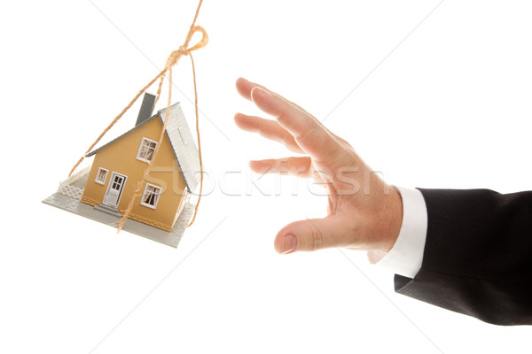 Swinging House and Business Man's Hand Reaching or Pushing Stock photo © feverpitch