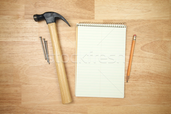 Pad of Paper, Pencil, Hammer and Nails Stock photo © feverpitch