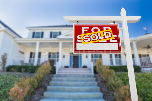 Left Facing Sold For Sale Real Estate Sign In Front of House. Stock photo © feverpitch